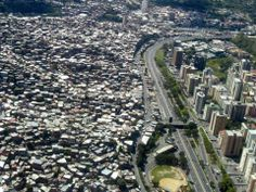 Caracas, Venezuela, where of the city's population lives within the slums. The shacks within these areas are referred to as ranchos and they fill the hillsides around the city. Sierra Nevada, Places Around The World, Around The Worlds, Fotografia Social, Walled City, Slums, The Real World, Urban Landscape, Architecture