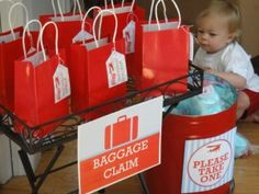 "If you are setting up a gift table or giving out favor bags, you could create a ""baggage claim"" area like this one."