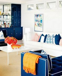 The red/orange accents pop against the white and deep blue palate.