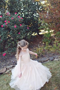 Darling flower girl in tulle! | J Woodbery Photography via @Matty Chuah Bridal Detective