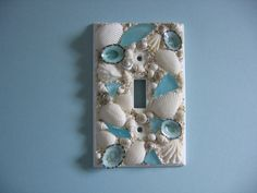 Just ordered for our remodeled mud room. Seashell and Seaglass Encrusted Single Light Switch Plate Cover - Aqua and White Beach Theme Bathroom, Beach Room, Beach Bathrooms, Seashell Bathroom, Seashell Projects, Seashell Crafts, Beach Crafts, Crafts With Seashells, Switch Plate Covers