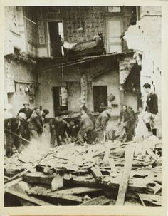 Cherbourg Citizens Dig Out. France -- Returning to their homes after the capture of Cherbourg by the Allies, citizens of the French city start the important task of digging out the debris to start reconstruction operations. The scene of the most bitter fighting on the Normandy Peninsula Date: 29/06/44