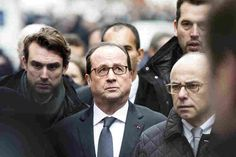 """""""France today faced a shock,"""" Hollande (center) said, according to a BBC interpreter. """"Today, I'm thinking about the victims."""""""