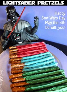 Celebrate Star Wars Day with these adorable and yummy Star Wars Lightsaber Pretzels. They are a great Star Wars Party Dessert or a fun snack for a Star Wars Movie Watching party.  Follow us for more fun Star Wars Birthday Party ideas and May the 4th be with you!