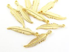 10 Tribal Feather Charms  22k Matte Gold Plated by LylaSupplies