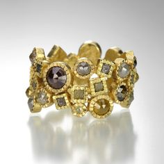 This Todd Reed ring has it all! A plethora of diamonds in varying colors, sizes and shapes, perfect for someone who truly appreciates the natural wonders of the earth. Set into rich, textured 18k yellow gold, the rose cut diamonds equal 5.025 carats total and the raw diamond cubes equal 0.912. Whether you are looking for an alternative wedding band or the perfect right hand diamond ring, this could be it! @quadrum
