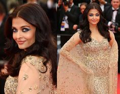 Aishwarya Rai Looks Stunning In Gold Cape Gown At The 69th Film Festival In Cannes