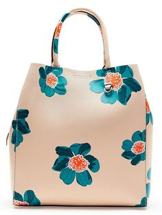 Florals aren't just for your tops and dresses this spring. We're loving this cheerful peach leather tote bag with blue and orange floral print Floral Tote Bags, Bags 2017, Unique Purses, Purses And Handbags, Tote Handbags, Beautiful Bags, My Bags, Fashion Bags, Carrie