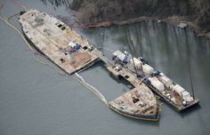 The Davy Crockett, shown in an aerial view last March, was surrounded by a cofferdam and dismantled in place.