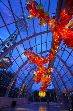 The Space Needle towers over the Glasshouse at the new Dale Chihuly Garden and Glass museum at the Seattle Center.