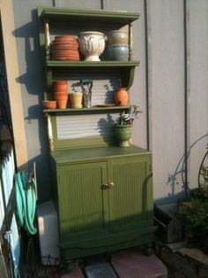 $17 Potting Bench, made from a wood door, cabinet, and scrap wood.