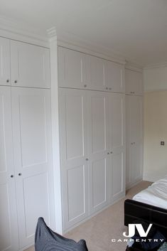 Tall fitted wardrobe with cupboards over the top and main sections at the bottom, it was built around chimney breast with middle section stick out slightly to create more space inside and an extra detail to this amazing design. To add contrast to the top part original coving was installed by specialised company wich can be arrang on request.