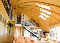 Круглый дом, его преимущества, экономия на строительных материалах, основные принципы возведения