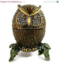 """This intriguing Owl Trinket Box has the beloved Swarovki Clear Diamond """"like"""" Crystals accenting the entire breast area.  Made of Brass, with a highly detailed body in a bronze and gold coloring, this sweetie is just gorgeous and is surely a collectible piece.  The bejeweled box is enameled and hand- painted on a brass base, that is baked, polished and embellished with the sparkling with these dazzling crystals accenting this highly detailed Owl.  The eyes are also embellished with these ..."""