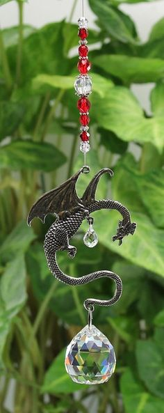 Fantasy Dragon Suncatcher, Crystal Sphere Ball, Medieval Goth Gothic Creature, Hanging Window Decoration, Rainbow Maker, Ideal Gift  27DR15 by CatchingAngels on Etsy https://www.etsy.com/au/listing/262857703/fantasy-dragon-suncatcher-crystal-sphere