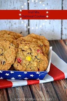 Take the tried and true old fashioned oatmeal cookie and add your favorite trail mix to create these chewy delicious Trail Mix Oatmeal Cookies! #cookies #gameday #recipes #dessert #food #ladybehindthecurtain