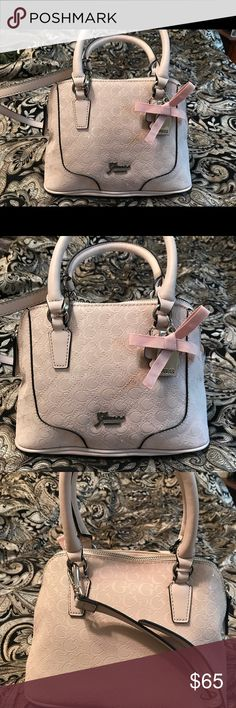 GUESS Crossbody Satchel NEW w/o Tags.   Never used. Still has the paper inside.   Bought it for my mom but she doesn't like pink (lol). Guess Bags Crossbody Bags