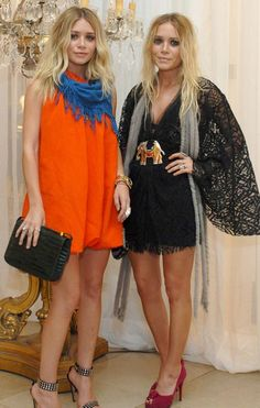 Ashley and Mary-Kate Olsen both wearing Elizabeth & James for the launch of their label Elizabeth & James at Nieman Marcus NYC oct 24th 2007.......
