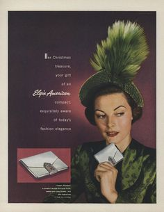 """1948 - TRIFARI - ADS - Her Christmas treasure, your gift of an Elgin American compact, exquisitely aware of today's fashion elegance. """"'Letter Perfect' in jeweler's bronze and silver finish, sealed with Trifari jewels"""". Vogue - December 1, 1948"""