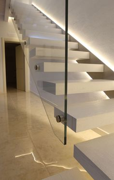 Great use of LED strip light to create a glowing stringer at staircase!: