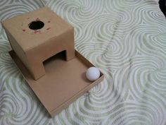 Object Permanence box made with cardboard boxes, for 8 month Ziona