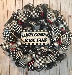 This 24 black and white checkered flag wreath is the perfect front door wreath for Indy 500 fans, NASCAR fans, racing fans all over. Made with black and white deco mesh. Decorated with black with white polka dot wired ribbon, black and white checked wired Flag Wreath, Door Wreath, Artificial Boxwood Wreath, Race Car Themes, Year Round Wreath, White Wreath, Greenery Wreath, Checkered Flag, Deco Mesh Wreaths