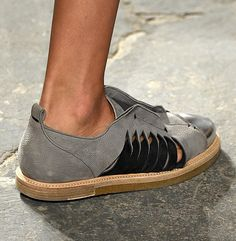 maiyet:  The new Syd Sneaker in grey nubuck lights up each step with a metallic toe cap and contrast twisted side slits. Look 28 from the SS16 runway.