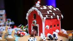 Gingerbread holiday inspiration with a twist. Check out the gingerbread barn and marzipan animals in this great display.