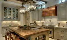 like the barn wood countertop and copper vent hood