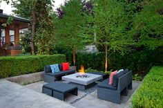 Sumptuous cast iron fire pit in Patio Contemporary with River Rock Garden