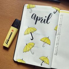 April bullet journal cover page, hand lettering, umbrella drawings. | @bujomaartje
