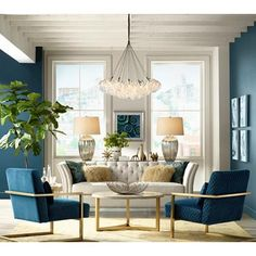 Blue is all the rage - love the chairs with brass legs and the industrial chandelier