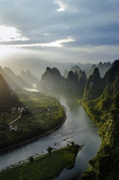 The Li River in Guilin, China is a year-round delight, just as stunning under blazing blue skies or wrapped in winter mists!