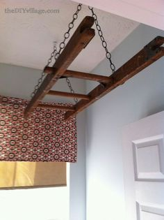 laundry room ladder drying rack, laundry room mud room, repurposing upcycling, Two toggle ceiling hooks on swivels attach the chain to the ceiling Old Ladder, Vintage Ladder, Hanging Ladder, Wooden Ladder, Laundry Room Drying Rack, Ceiling Hooks, Laundry Room Remodel, Attic Remodel, Small Laundry Rooms