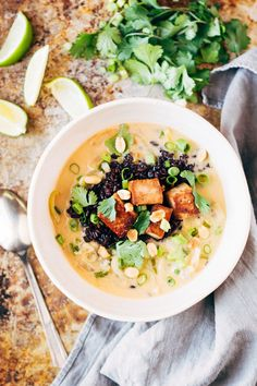 {Ginger and lemongrass infused Thai soup with crispy tofu and wild rice.}