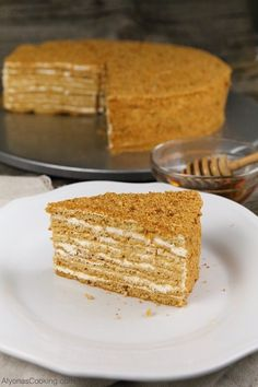honey-cake-recipe-medovik-russian-store-copycat Our local Russian Store sells these amazingly soft, spongey and thin cake layers that make for one of the most delicious honey cake sold in the area, known as the Medovik. Russian Honey Cake, Russian Cakes, Russian Desserts, Russian Recipes, Honey Cake Recipe Easy, Easy Cake Recipes, Unique Recipes, Dessert Recipes, Medovik Cake Recipe