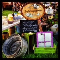 Elkhorn Flea Market. Galvanized tubs, old ladder, planters, and my sign.