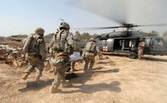 Soldiers transport a trauma victim to a U.S. Army medical helicopter in Tarmiyah, Iraq, Sept. 30, 2007. (Photo by Navy Mass Communication Specialist 2nd Class Summer M. Anderson)