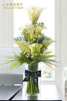 Same day flower delivery through online florist Memento Flowers Florist London your local flower shop, send flowers, wedding flowers & funeral flowers. Ikebana, Lys Calla, Calla Lily, Calla Lillies, Church Flowers, Funeral Flowers, Vase Arrangements, Floral Centerpieces, Centrepieces