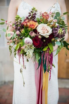burgundy bouquet - photo by Krista Esterling Photography http://ruffledblog.com/modern-meets-1920s-wedding-editorial #weddingbouquet #flowers #bouquets