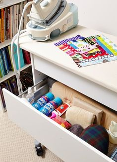 Turn the top of a shelf or dresser into a pressing surface to help stay organized in your sewing/crafting space.