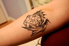dice tattoos | Cool scratchy design of a tribal dragon wrapped around a 20sided dice