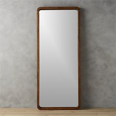 "Shop acacia wood 33""x73"" floor mirror.   Solid sustainable acacia wood comes full length to showcase a sweeping grain and warm hi/lo tones.  Standing at 6 feet high, handcrafted wood frame borders an inset mirror with 3D depth."