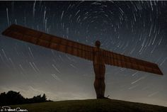 What a stunning shot! It took much of the night, but astrophotographer Peter Greig has now given this angel a halo, in the form of star trails. The Angel of the North is a gigantic sculpture located in Gateshead, England. It is a 200 ton steel sculpture of an angel/being with airplane wings that measures 20 meters (66 feet) in height, with wings measuring 54 meters (177 ft) across — making it as tall as 4 double-decker London buses with a wingspan as big as a jumbo jet.