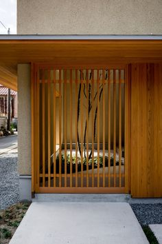 This family house in Japan's Shiga prefecture was designed by local studio Hearth Architects around an indoor garden planted with a tree. Japanese Home Design, Japanese Interior, Japanese Door, Japanese House, Japanese Architecture, Contemporary Architecture, Interior Garden, Interior And Exterior, Humble House