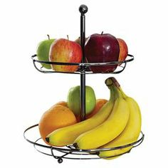 """2-tier openwork chrome fruit basket in black with a ball finial detail.   Product: Fruit basketConstruction Material: Chrome Color: BlackFeatures:  Two-tiersBall finial detail Dimensions: 13.6"""" H x 10.6"""" Diameter"""