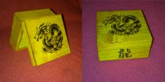 A small wooden box with dragon design.