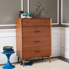 Inspired by American modern design, the Mid-Century 4-Drawer Dresser borrows its slim legs, angled face and understated retro details from iconic '50s and '60s furniture silhouettes. Antique bronze-finished hardware provide an unexpectedly luxe twist to the clean-lined silhouette. FSC certified wood.