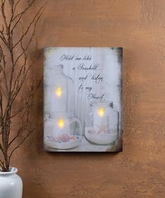 """Available @ Boscov's Online. Fond seaside memories are sure to be inspired by the Ohio Wholesale Lighted Seashell Jar Candle Canvas. Size x reads """"Hold me like a seashell and listen to my heart. Mason Jar Lamp, Candle Jars, Candle Picture, Seashell Candles, Lighted Canvas, Canvas Lights, Flickering Lights, Ocean Themes, Light Art"""