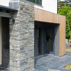 Timber cladding, stone and blue engineering brick